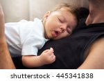 cute baby sleeping on father s... | Shutterstock . vector #445341838