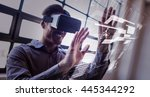 Stock photo interface against businessman using virtual reality device 445344292