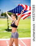 happy female athlete holding up ... | Shutterstock . vector #445375585