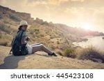 fashionable girl hiking | Shutterstock . vector #445423108