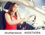 young confident woman piloting... | Shutterstock . vector #445474396