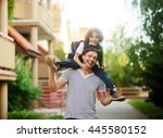 the father carries on his... | Shutterstock . vector #445580152