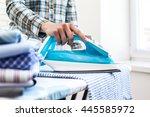 closeup of woman ironing... | Shutterstock . vector #445585972