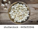 Popcorn In A Bowl On Wooden...