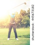 mature golfer on a golf course... | Shutterstock . vector #445673182