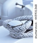 Close-up of a moored rope on a luxury yacht.  - stock photo