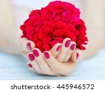 cupped hands with pink... | Shutterstock . vector #445946572