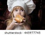 little girl eating cake  suit...   Shutterstock . vector #445977745