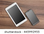 tablet and mobile phone on... | Shutterstock . vector #445992955