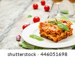 meat lasagna on a white wood... | Shutterstock . vector #446051698