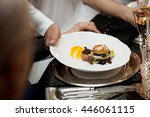 waiters serving a dish made... | Shutterstock . vector #446061115