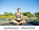 Woman Stretching Hand At Park