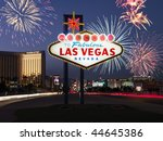 Stock photo lighted sign reading welcome to fabulous las vegas nevada with fireworks in background 44645386