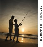 Father And Son Fishing In Ocea...