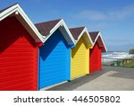 Row Of Colorful Beach Huts At...