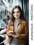 charming brunette girl using... | Shutterstock . vector #446572042