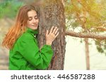 Woman Hug And Kiss A Tree Trun...