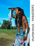 Small photo of the American Indian in national clothes looks afar.