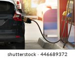 filling gasoline in car with a ... | Shutterstock . vector #446689372