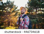 man with a hat smiling in... | Shutterstock . vector #446734618