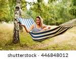 young blonde woman resting on... | Shutterstock . vector #446848012
