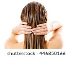 woman applying hair conditioner.... | Shutterstock . vector #446850166