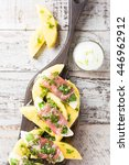 rolls of mozzarella  basil and...   Shutterstock . vector #446962912