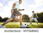 dad son playing football... | Shutterstock . vector #447068062