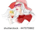 young pretty woman with hat...   Shutterstock .eps vector #447070882
