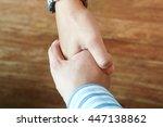 Businessman Hand Hold Together...
