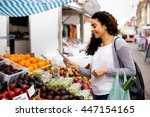 young woman at the market... | Shutterstock . vector #447154165
