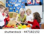nursery teacher playing kitchen ... | Shutterstock . vector #447182152