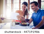 couple using a digital tablet... | Shutterstock . vector #447191986