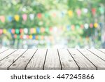 empty wooden table with party... | Shutterstock . vector #447245866