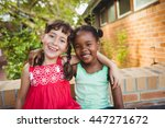 two friendly girl posing and...   Shutterstock . vector #447271672