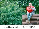 Boy Hugging A Big Red Heart....