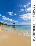 mauritius beach thatch jetty.... | Shutterstock . vector #447439132