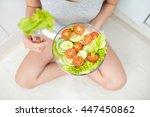 asian woman eating salad  focus ... | Shutterstock . vector #447450862