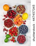 various fresh fruits in bowls... | Shutterstock . vector #447457345