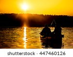 two fishermen are silhouetted... | Shutterstock . vector #447460126