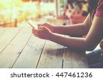 side view of a woman using...   Shutterstock . vector #447461236