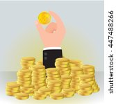 hand is pick up gold coins ... | Shutterstock .eps vector #447488266