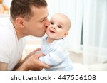happy father with sweet baby in ... | Shutterstock . vector #447556108