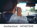 young man driving a car ... | Shutterstock . vector #447607345