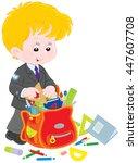 schoolboy completing his... | Shutterstock .eps vector #447607708