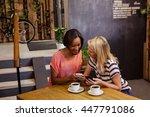 friends using smartphones in...   Shutterstock . vector #447791086