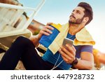 young athlete man drinking...   Shutterstock . vector #447928732