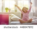 a nice child girl enjoys sunny... | Shutterstock . vector #448047892