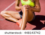 female athlete warming up on... | Shutterstock . vector #448143742