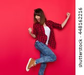 young woman in red lumberjack... | Shutterstock . vector #448162216